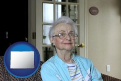 colorado map icon and a senior woman in an assisted living facility