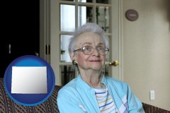 wyoming map icon and a senior woman in an assisted living facility